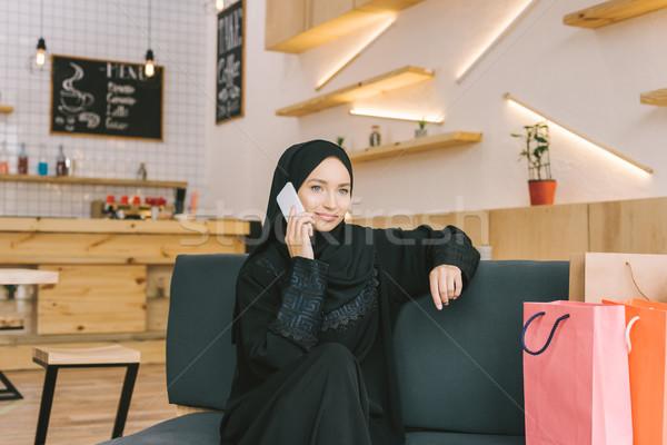 muslim woman talking by phone Stock photo © LightFieldStudios