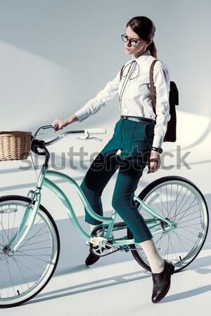woman with vintage bicycle Stock photo © LightFieldStudios