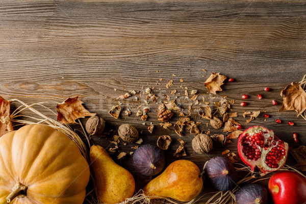 pumpkin, seasonal fruits and walnuts Stock photo © LightFieldStudios