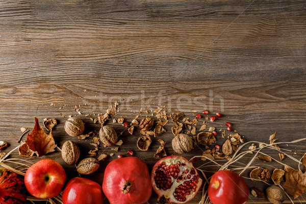 pomegranates, apples and walnuts Stock photo © LightFieldStudios