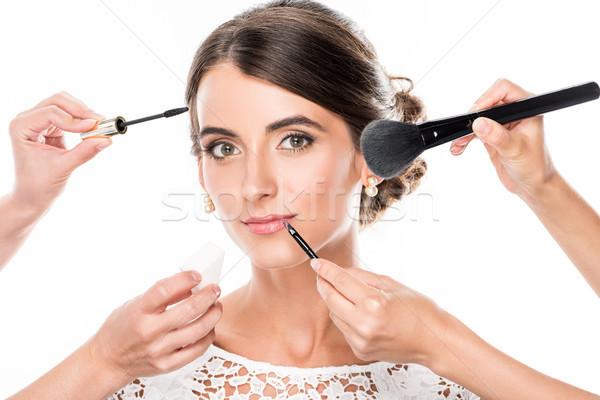 woman getting makeup Stock photo © LightFieldStudios