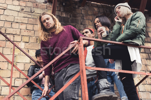 Elegáns fiatalok lépcsősor csoport ipari épület Stock fotó © LightFieldStudios