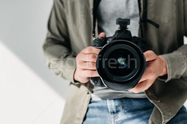 photographer with digital photo camera Stock photo © LightFieldStudios