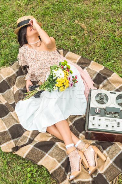stylish girl with camera in park Stock photo © LightFieldStudios