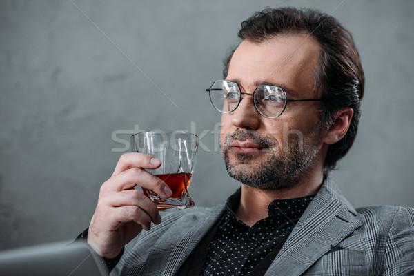 Affaires potable whiskey pensive âge moyen lunettes Photo stock © LightFieldStudios