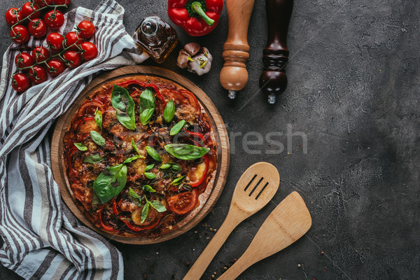 top view of pizza with wooden spatulas on concrete table Stock photo © LightFieldStudios