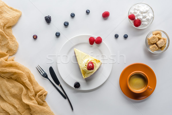 top view of piece of cake with berries and coffee on white table Stock photo © LightFieldStudios