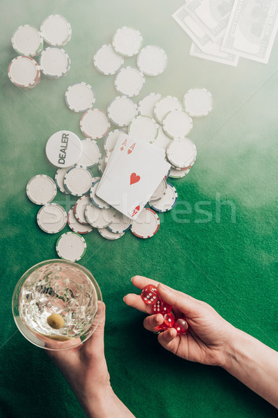 Woman playing dice game by casino table Stock photo © LightFieldStudios