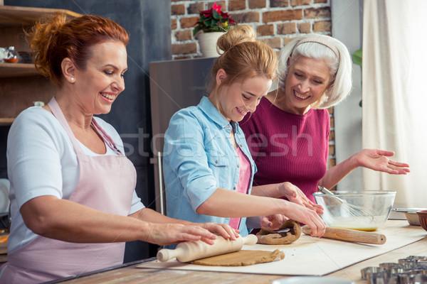 Family preparing gingerbread cookies Stock photo © LightFieldStudios