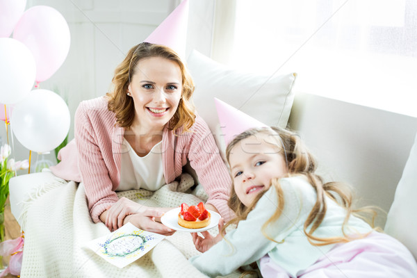 Mother and daughter with strawberry cake Stock photo © LightFieldStudios