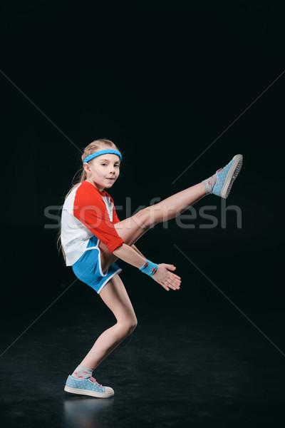 Cute девушки спортивная одежда изолированный Сток-фото © LightFieldStudios