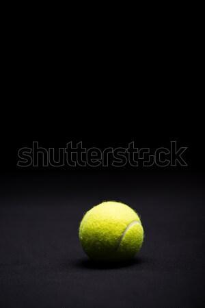 Tennis ball on black Stock photo © LightFieldStudios