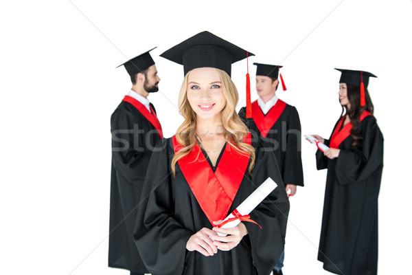 Boldog fiatal nő tart diploma barátok áll Stock fotó © LightFieldStudios