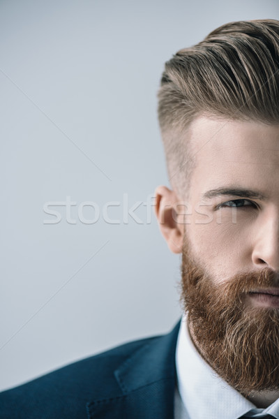 Cropped shot of handsome bearded businessman looking at camera Stock photo © LightFieldStudios