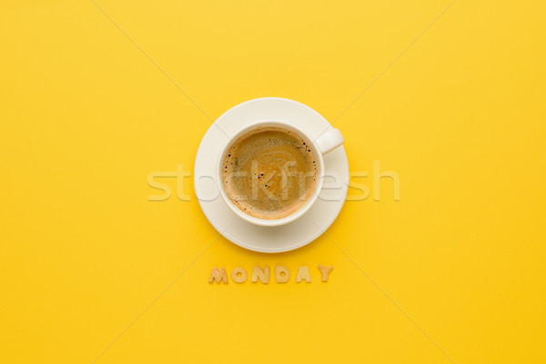 Stock photo: top view of cup of espresso coffee and monday lettering isolated on yellow