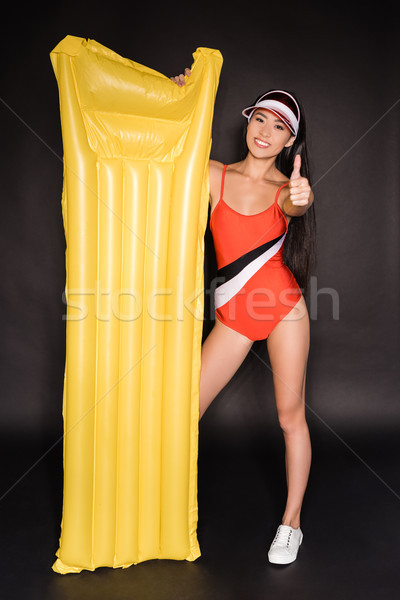 woman in swimsuit and visor with pool mattress Stock photo © LightFieldStudios