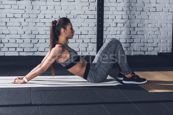 Stockfoto: Vrouw · zijaanzicht · jonge · atletisch · opleiding