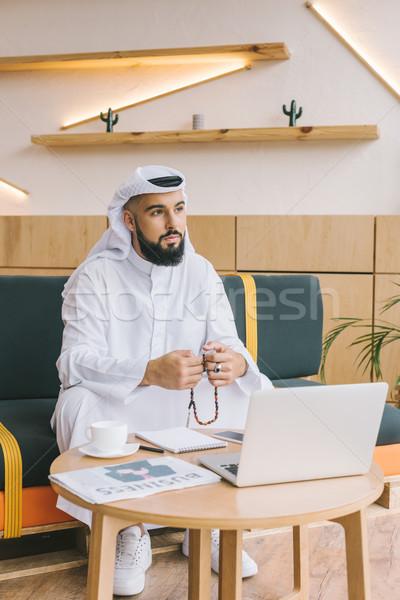 Muszlim üzletember ül kanapé ima gyöngyök Stock fotó © LightFieldStudios