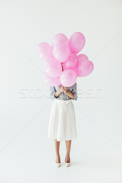 Stock photo: woman holding balloons