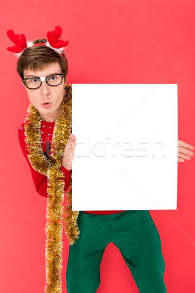 man in sweater with blank banner Stock photo © LightFieldStudios