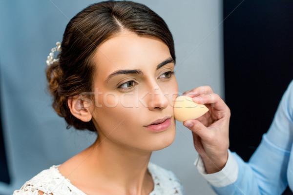woman getting makeup done Stock photo © LightFieldStudios
