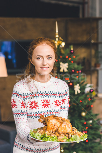 woman with fried chicken for christmas Stock photo © LightFieldStudios