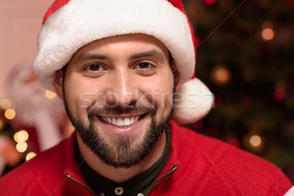 man in santa hat Stock photo © LightFieldStudios