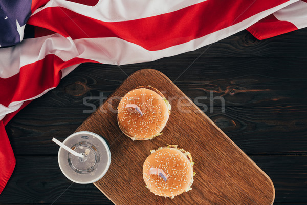 top view of arranged burgers and soda drink with american flag on wooden tabletop, presidents day ce Stock photo © LightFieldStudios