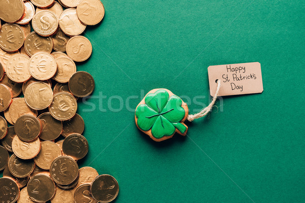 top view of icing cookie in shape of shamrock and golden coins on green, st patricks day concept Stock photo © LightFieldStudios