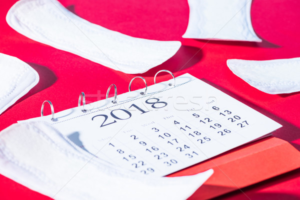 scattered daily liners and calendar on red Stock photo © LightFieldStudios