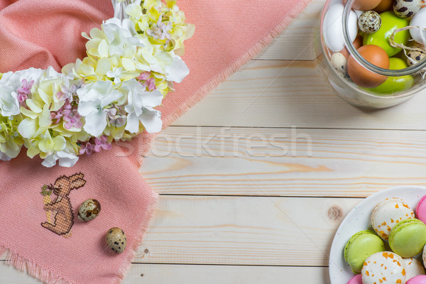 Easter eggs and macarons Stock photo © LightFieldStudios