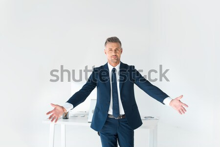 Cheerful businessman triumphing Stock photo © LightFieldStudios