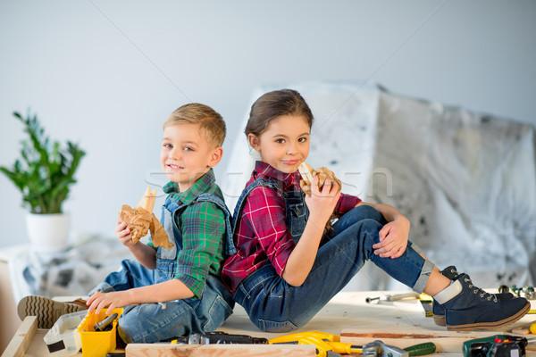 Kids eating in workshop Stock photo © LightFieldStudios