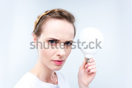 focused woman with light bulb Stock photo © LightFieldStudios