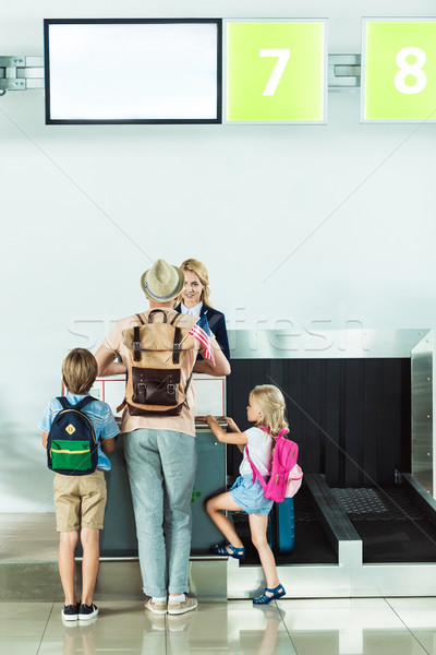 family at check in desk at airport Stock photo © LightFieldStudios