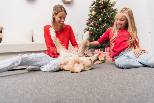 happy mother and daughter with dog  Stock photo © LightFieldStudios