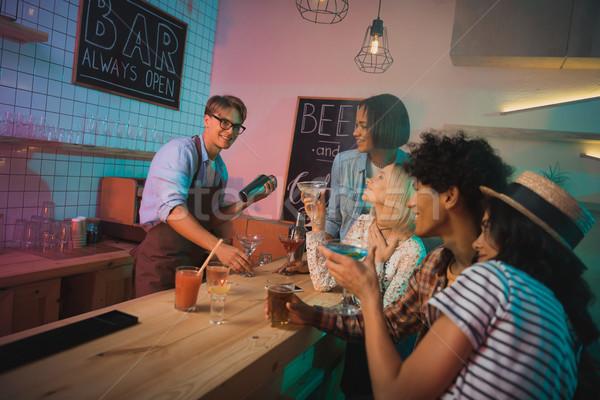 barmen making alcohol cocktail Stock photo © LightFieldStudios