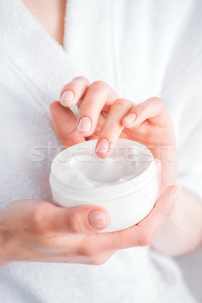 Stock photo: woman holding face cream jar