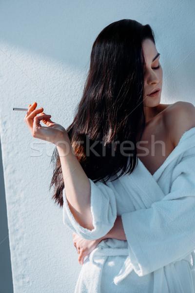 Mulher atraente fumador cigarro tiro jovem branco Foto stock © LightFieldStudios