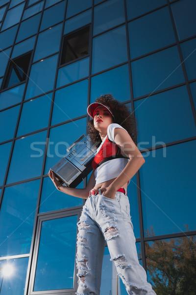 beautiful woman with boombox Stock photo © LightFieldStudios