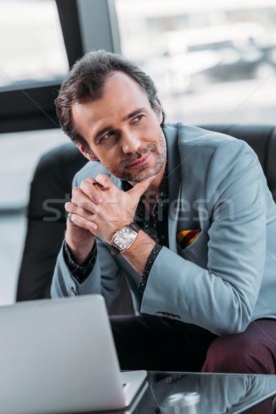 Işadamı dizüstü bilgisayar kullanıyorsanız dalgın orta yaşlı ofis Stok fotoğraf © LightFieldStudios