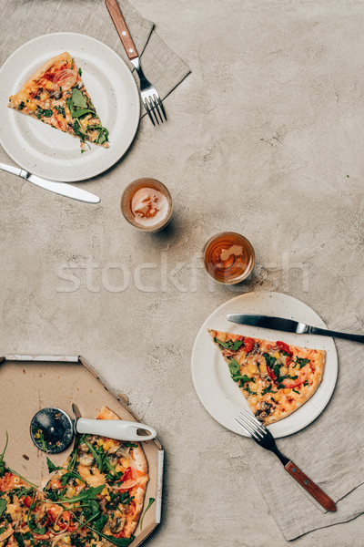Dinner template with pizza slices on plates and drink glasses on light background Stock photo © LightFieldStudios