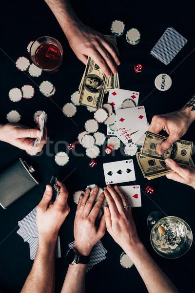 Insanlar oynama poker kumarhane tablo para Stok fotoğraf © LightFieldStudios