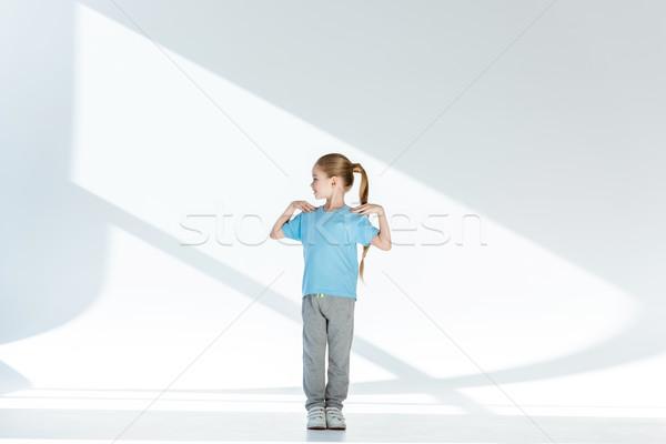 Teljes alakos kilátás boldog kislány sportruha testmozgás Stock fotó © LightFieldStudios