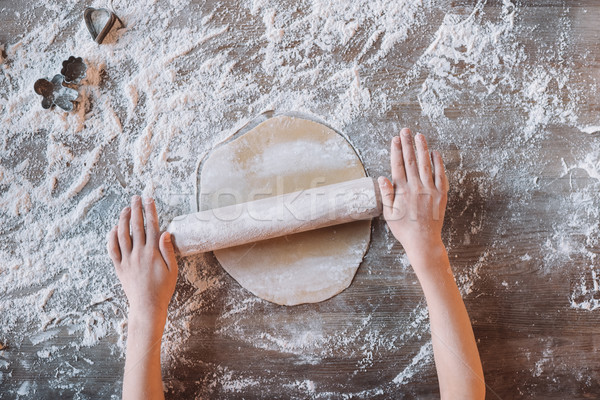 'Partial top view of child kneading dough for cookies Stock photo © LightFieldStudios