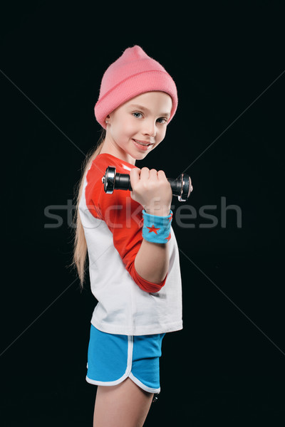 girl training with dumbbells isolated on black. action sport concept Stock photo © LightFieldStudios