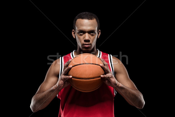 African american basketball player posing with ball on black  Stock photo © LightFieldStudios