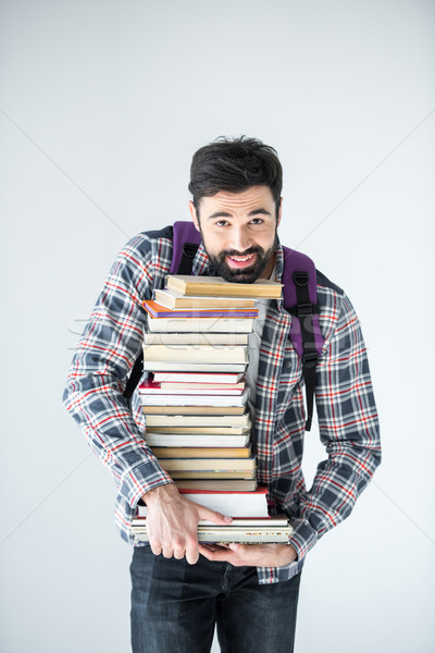 bearded student holding pile of books on white with copy space Stock photo © LightFieldStudios