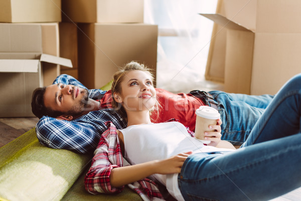 couple resting in new house Stock photo © LightFieldStudios