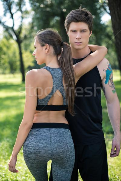 young couple in sportswear Stock photo © LightFieldStudios